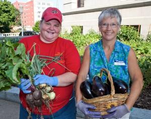 Volunteers holding vegetables